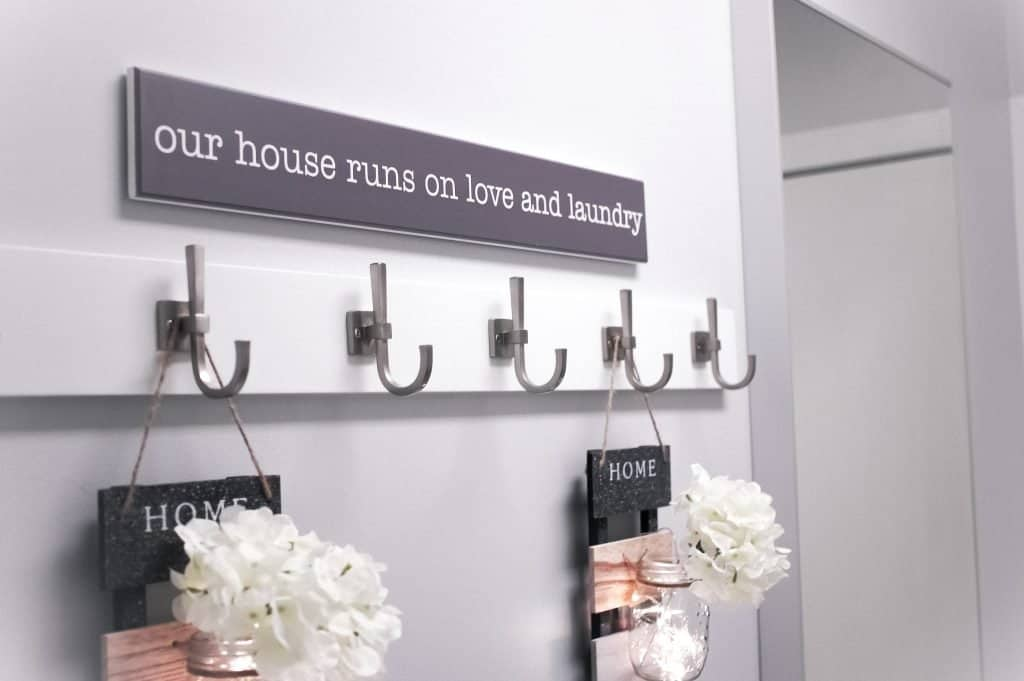 House runs on love and laundry sign