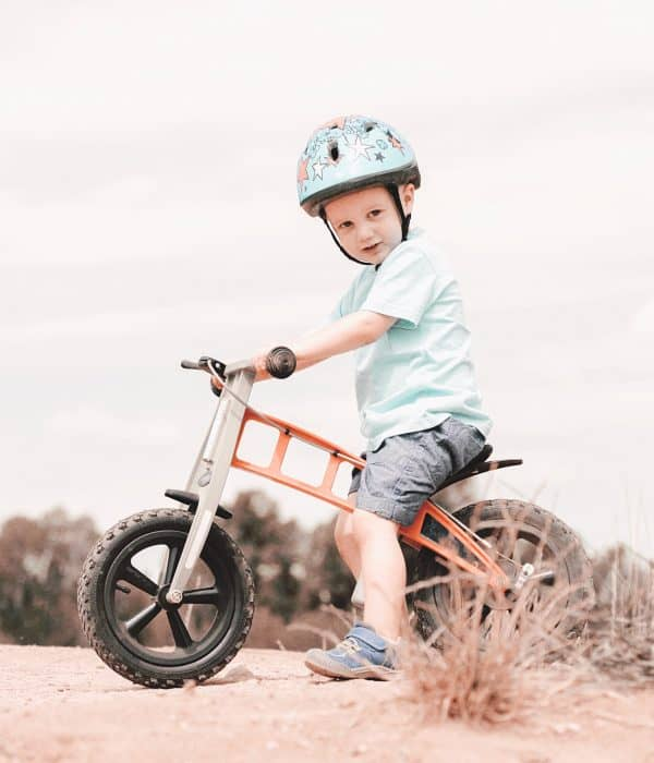 Toddler on a Strider Bike at a Dirt Track Wearing Helmet | Brunette on a Mission Blog