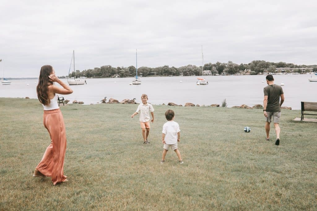 Playing soccer with our two boys on the shores of Lake Minnetonka, Excelsior, MN | Brunette on a Mission Blog | #familyphotos