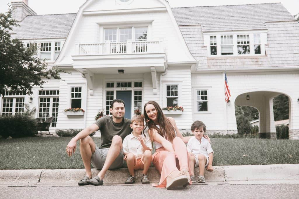 Posing in front of my dream home in Excelsior, MN with two of our kids. Just sitting on a sidewalk | Brunette on a Mission Blog