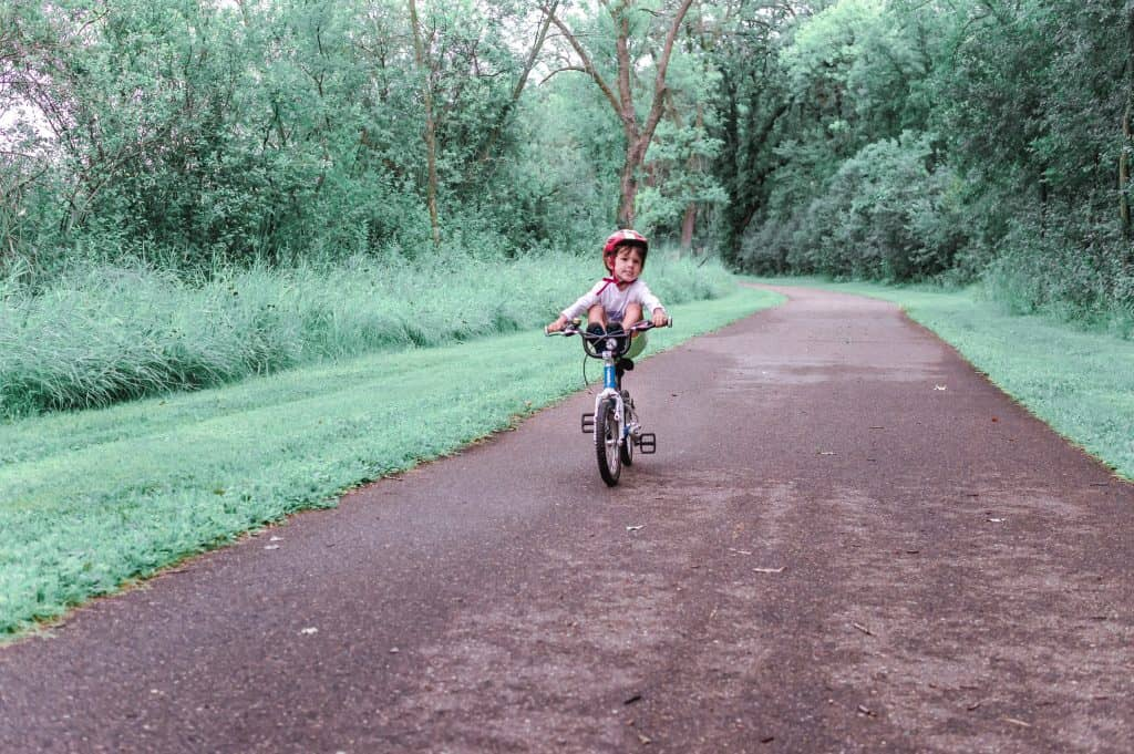 WOOM 5 Bike Review | Our 3-year-old riding with his feet on the handlebar on his Woom 2 bike! He loves showing off on his real bike.