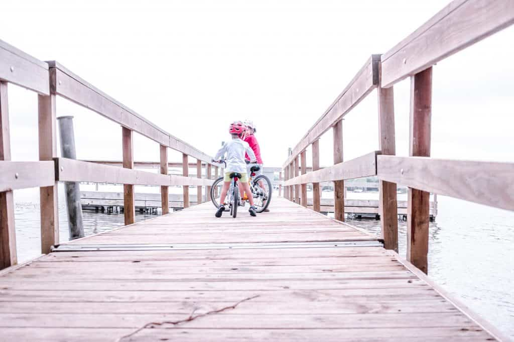 Woom 5 Bike Review | Our kids chatting on a fishing pier.