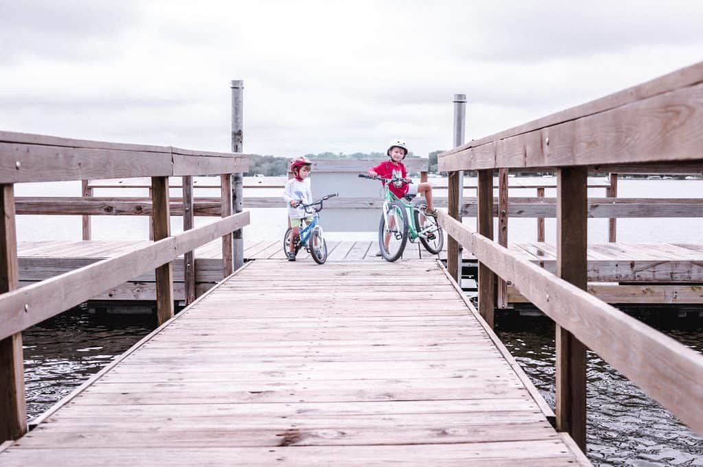 Our kids hanging on a fishing pier with their bikes.