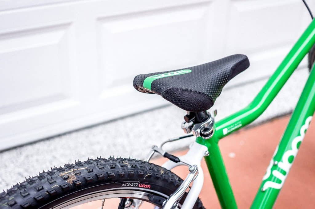 Padded saddle protects bike when leaning on walls.