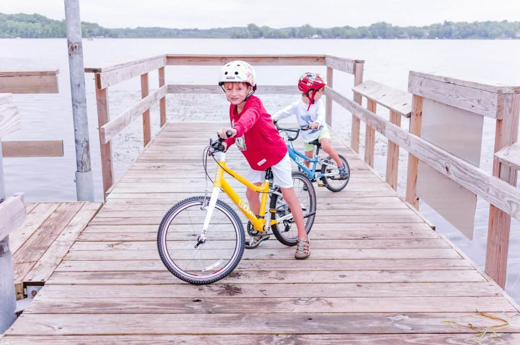 Woom bikes | Our kids on a fishing pier on their 16 inch and 20 inch bikes.