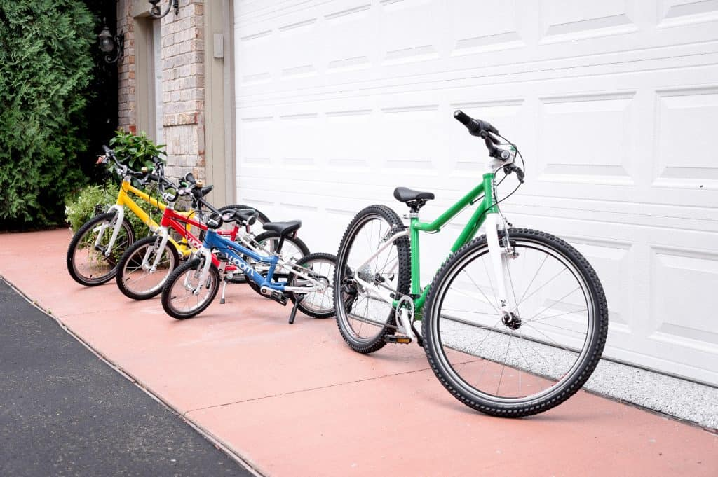 Woom 5 Bike Review | Collection of our wooms in the driveway.