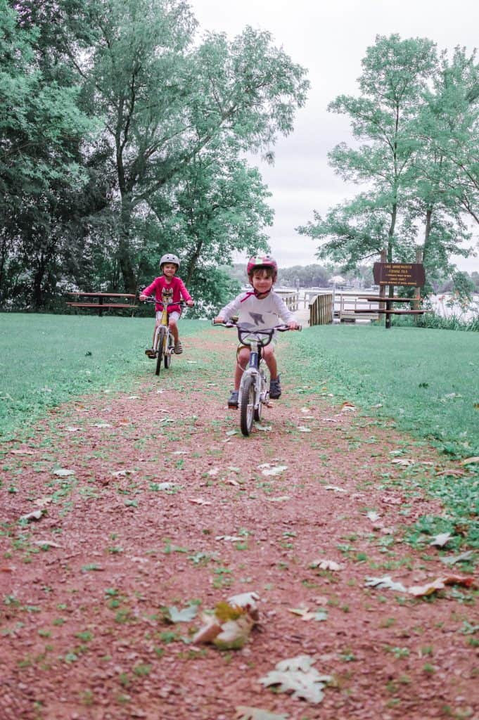 Woom 5 Bike Review | Our kids riding on a fine gravel trail on their bikes.