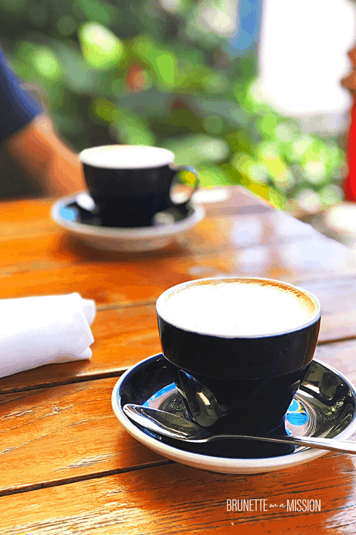 Guide to IF for Beginners - Two cups of cappuccino or coffee on a wooden table outside.
