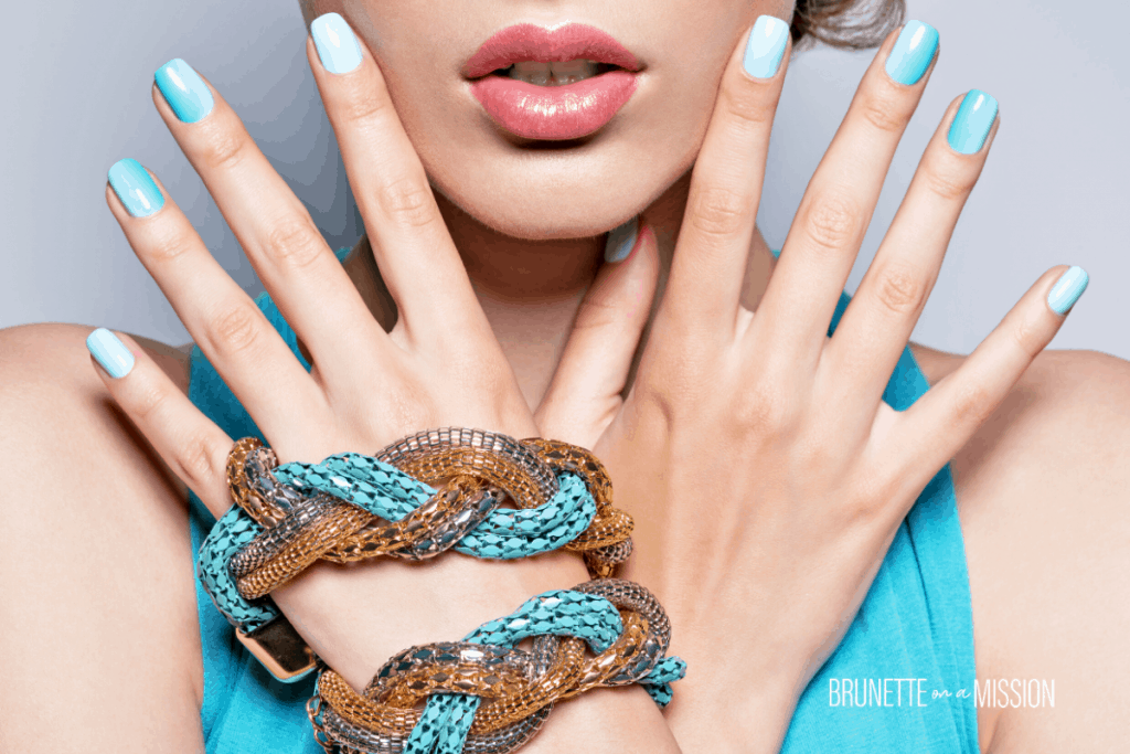 Beautifully manicured hands in light blue | Everything About the Green Nails Syndrome | Brunette on a Mission