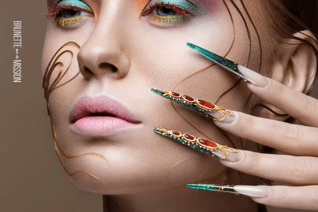 Closeup shot of a beautiful young woman with over-the-top long acrylic manicure and bright fashion makeup| Artificial Nails - All the Different Types of Fake Nails