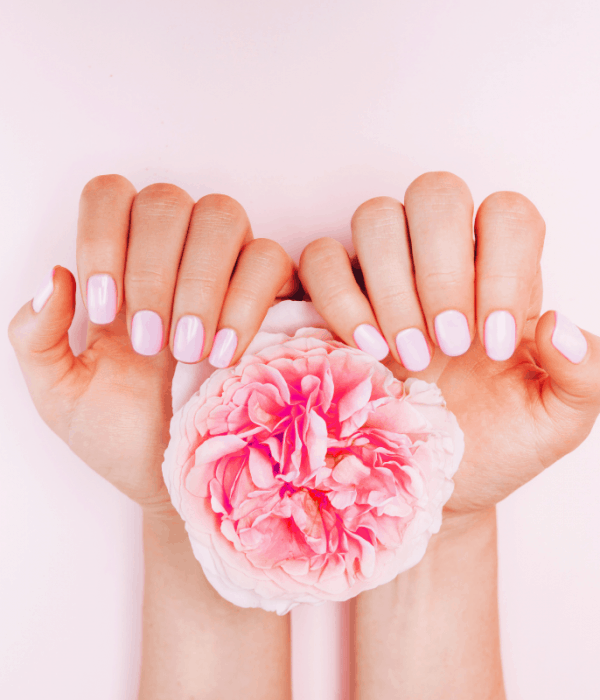 Picture of woman holding a peony and showing her beautiful manicure | Most comprehensive guide to silk wrap nails.